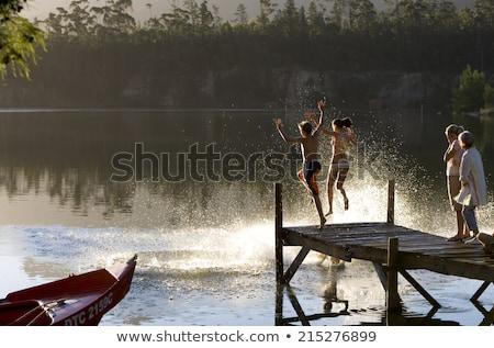 Kobieta stałego dok jezioro podróży zabawy Zdjęcia stock © IS2