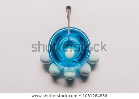 top view of glass with blue paint and chicken eggs on white surface, easter concept Stock photo © LightFieldStudios