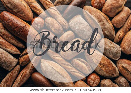 top view of arranged loafs of bread on wooden surface and bread lettering Stock photo © LightFieldStudios