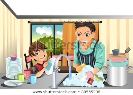 Son Helping Father In Washing Utensils Stockfoto © Artisticco