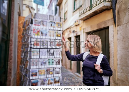 Woman choosing a postcard, smiling Stock photo © IS2