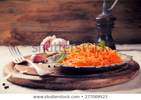 Stock photo: Spicy Korean style carrot salad on metal plate