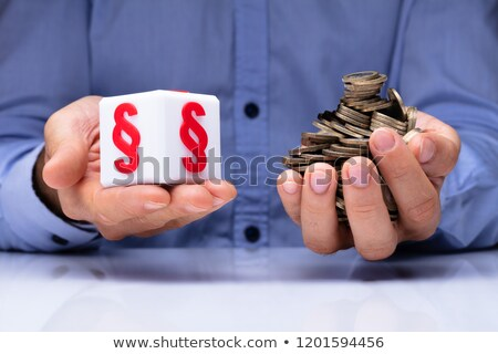 Man Holding Cubic Block With Paragraph Symbol And Coins Stock photo © AndreyPopov