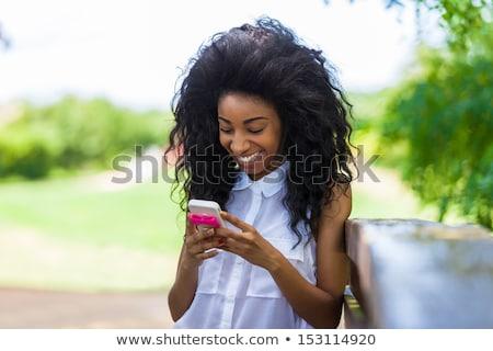 Feliz africano mulher jovem mentiras ao ar livre parque Foto stock © deandrobot