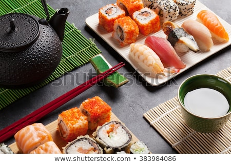 Green tea and sushi chopsticks. Japanese meal set Stock photo © karandaev
