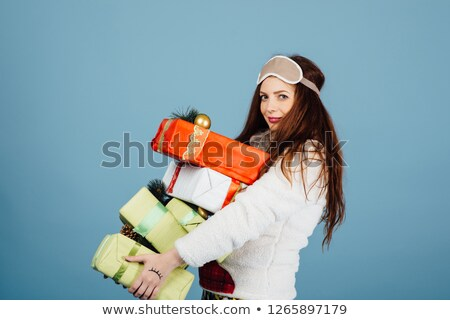 Bonitinho mulher jovem pijama em pé natal apresentar Foto stock © ruslanshramko