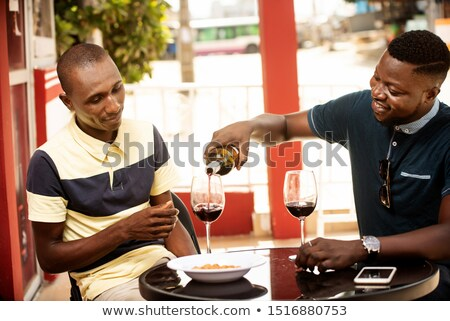 people at wine outdoor party man pouring red wine in to the win stock photo © dashapetrenko