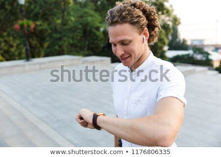 Stockfoto: Happy Curly Business Man With Briefcase Walking On Stairs