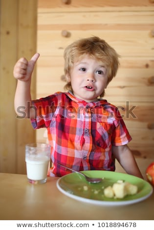 kid or blonde happy boy eating at table childhood and happiness independence breakfast morning stock photo © elenabatkova