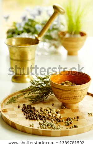 Metal mortar and pestle with rosemary on wooden background Stock photo © Melnyk