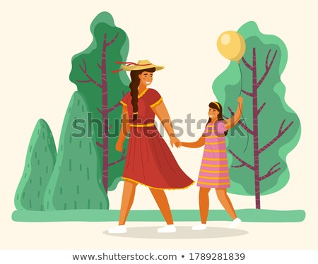 girl with balloon in hands walk in green city park stock photo © robuart