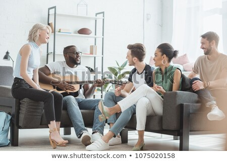 friends spending time and playing acoustic guitar stock photo © robuart
