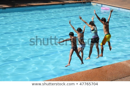 Group of children's jumping in pool Stock photo © Kzenon