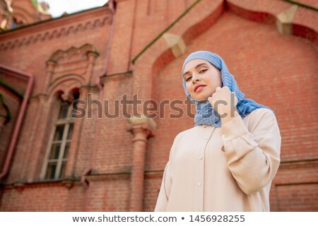 Young gorgeous Arabian woman standing on background of oriental temple Stock photo © pressmaster