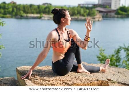 Omurga yarım poz genç kadın Stok fotoğraf © pressmaster