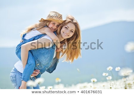 счастливым радостный матери дочь Daisy области Сток-фото © Lopolo