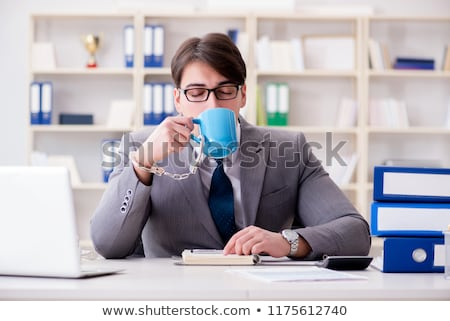 Stock photo: Businessman chained with handcuffs to his coffee