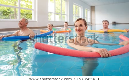 Patients during remobilization in a health center doing aquarobics Stock photo © Kzenon