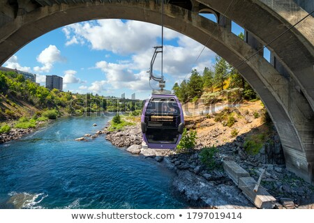Natural landscape with gondola on river under bridge Stock photo © barsrsind