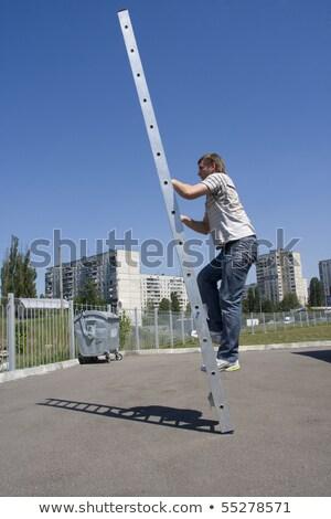 Shadow of man climbing ladder on asphalt Stock photo © nomadsoul1