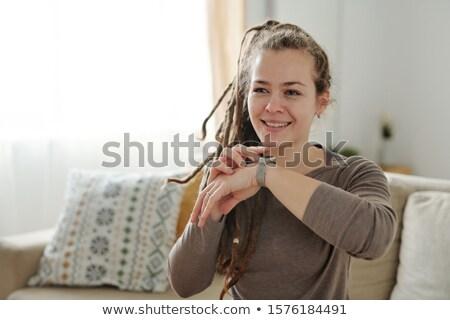 Niña feliz sonrisa con dientes mano cara relajante sofá Foto stock © pressmaster