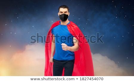 man in red superhero cape over night sky Stock photo © dolgachov