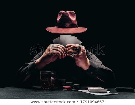 Poker oyuncu genç oynama adam kartları Stok fotoğraf © val_th