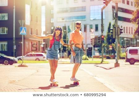 Pareja equitación skateboard calle de la ciudad verano Foto stock © dolgachov