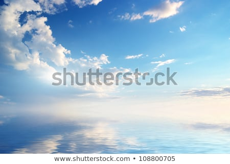 The sea reflect the sky in Peaceful evening Stock photo © Ansonstock