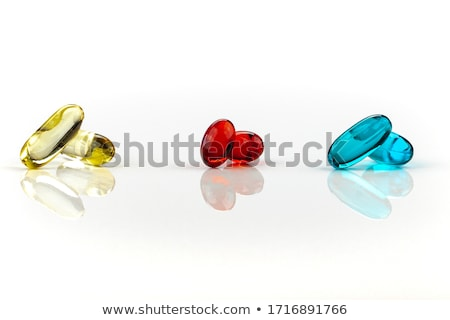 Stock photo: yellow blue capsules in red box