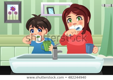 Brother And Sister Brushing Their Teeth Stockfoto © Artisticco