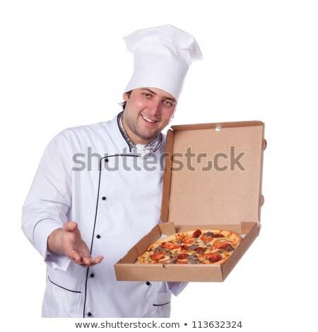 Italian chef bringing pizzas Stock photo © photography33