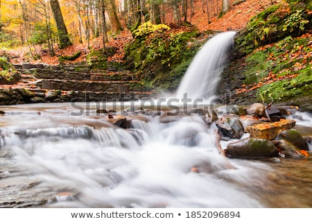 Cascading river in dry red rocks Stock photo © backyardproductions