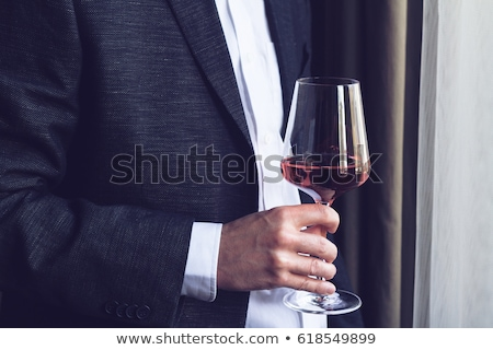 Sommelier holding up a glass of wine Stock photo © photography33