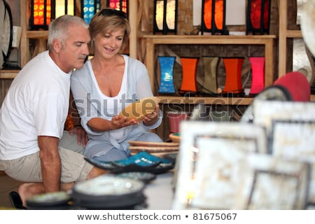 couple looking at local pottery on holiday stock photo © photography33