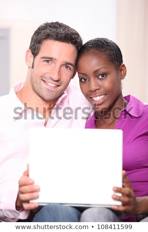 mixed couple heads joined with laptop Stock photo © photography33