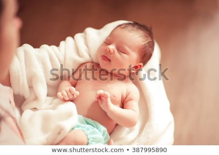 sleeping new born baby in mothers hands stock photo © tish1