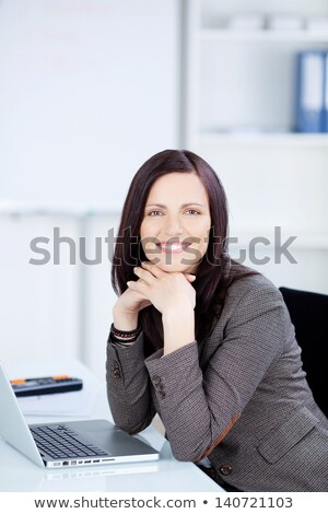 Business woman sat at desk in front of computer Stock photo © photography33