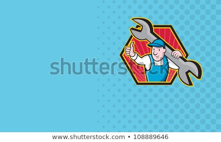 worker with giant spanner holding business card stock photo © photography33