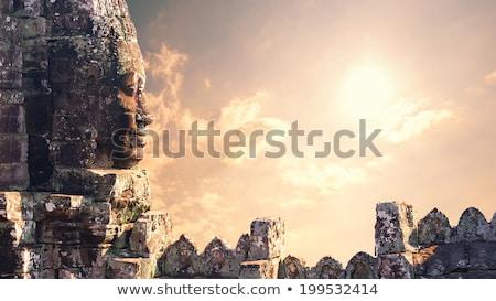 Foto stock: Faces · templo · pedra · torres · angkor · cidade