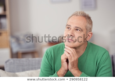 Smiling Middle Age Man with Hand to Chin in Thought Stock photo © scheriton