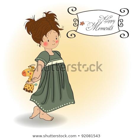 Młoda dziewczyna bed ulubiony zabawki żyrafa dziewczyna Zdjęcia stock © balasoiu