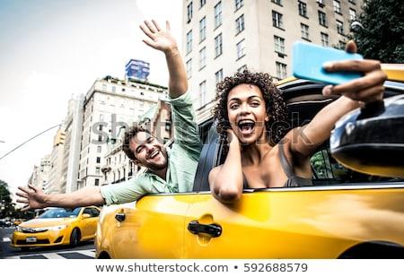 Portrait of a couple taking public transportation Stock photo © photography33