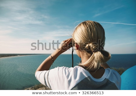 Young fair-haired woman with binoculars Stock photo © photography33