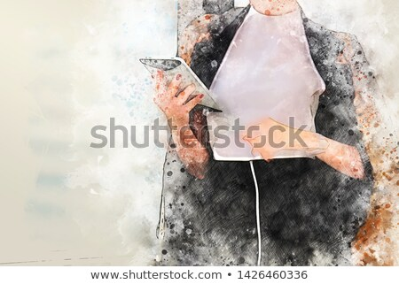 A businessman looking at a trowel. Stock photo © photography33