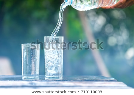 drink poured into a glass over white background stock photo © ozaiachin