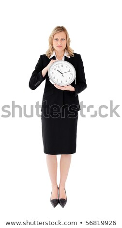 Unhappy businesswoman against white background holding  a clock Stock photo © wavebreak_media