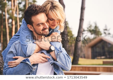 Wrapping arms around boyfriend Stock photo © photography33