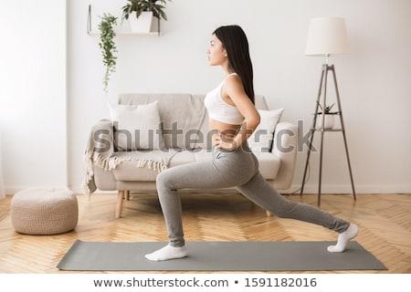 Fitness asian girl doing stretch exercise Stock photo © elwynn