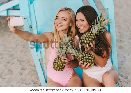Stock photo: Two girl friends posing by the seaside
